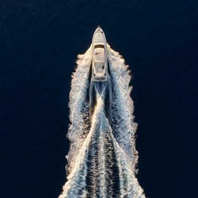 Aerial view on fast boat on blue Mediterranean sea at sunny day. Fast ship on the sea surface.